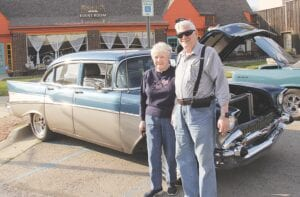 Don and Gretchen Peterson of Lapeer show off their 1957 Chevrolet Bel Air complete with fuzzy dice hanging from the review mirror and replica A&W carhop tray attached to the driver's window. The couple bought the car in 2015 to cruise in the annual Woodward Dream Cruise, reliving Gretchen's experience of cruising the iconic M-1 route where she grew up in Berkley, Mich. Photos by Wes Smith